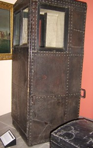 Plain leather covered sedan chair, 1700. Notice the metal brackets.