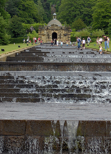 The step waterfall attracts tourists and waders.