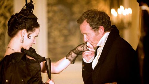 Mr. Merdle kisses Fanny's hand