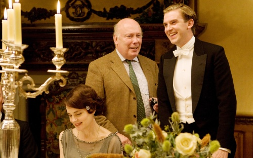 Julian Fellowes with Dan Stevens and Elizabeth McGovern.