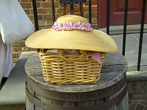 Outside the milliner's shop