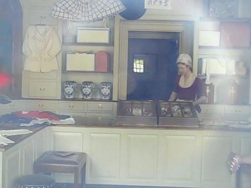 Inside the milliner's shop