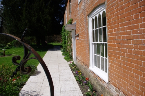 In this image one can readily see the window that Jane's brother, Edward, had installed in the drawing room. It overlooks the walled in garden.