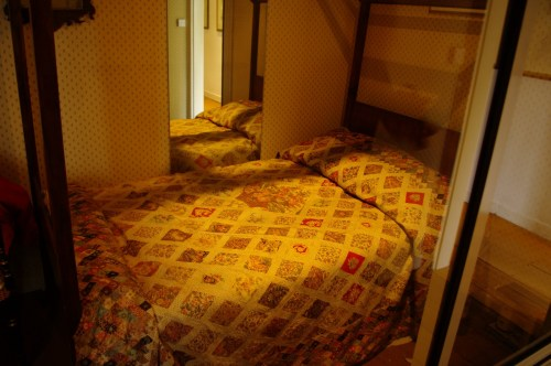 The bed with the diamond  pane quilt that Jane helped to sew. Chawton Cottage Image@Tony Grant