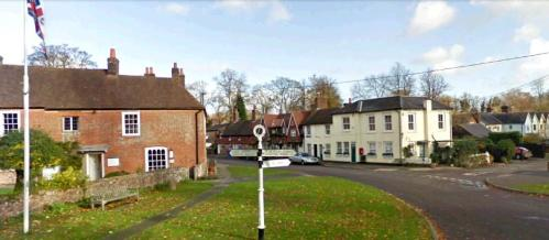 Chawton Cottage coming into full view, along with the cross roads sign