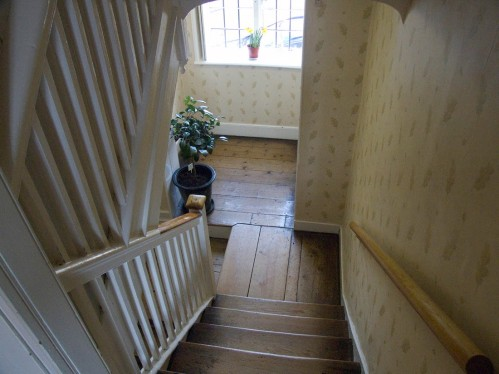 The stairs outside Jane's room. Chawton Cottage Image@Tony Grant