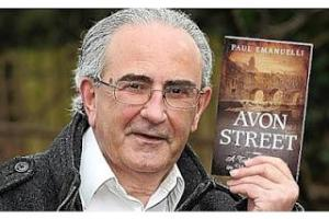 Paul Emanuelli holds up his novel, Avon Street