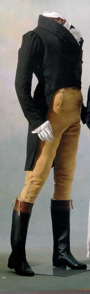 Country attire of buckskin breeches, clawhammer coat, and hessian boots.