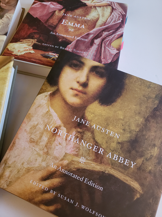 Image of the covers of Northanger Abbey (front) and Emma (back) by Jane Austen and published by Harvard University Press.