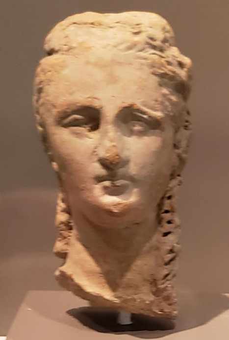 Terracotta Head of a Woman with Long Curls. Greek (South Italy), 3rd century B.C.