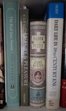 Spine of Jane Austen book-style jigsaw puzzle on book shelf