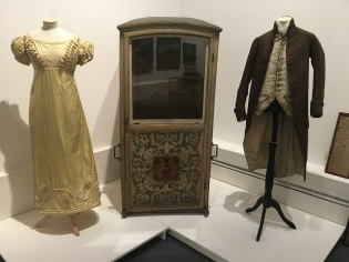 Image of Georgian costumes and a sedan chair