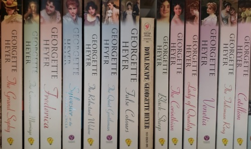 Image of Some of Vic's Georgette Heyer books in her collection.