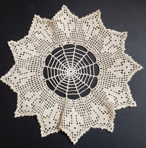 Image of a small hand-made doily.