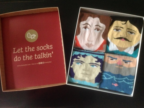 Image of The socks inside the box, with the byline of Let the socks do the talkin'
