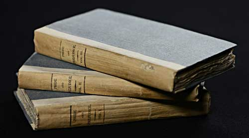 Image of a three-volume first edition of Pride and Prejudice bound in a simple publishers board. National Library of Scotland