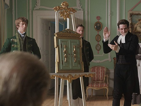 James and Bartholomew flank the frame as Mr Elton is about to reveal its contents.