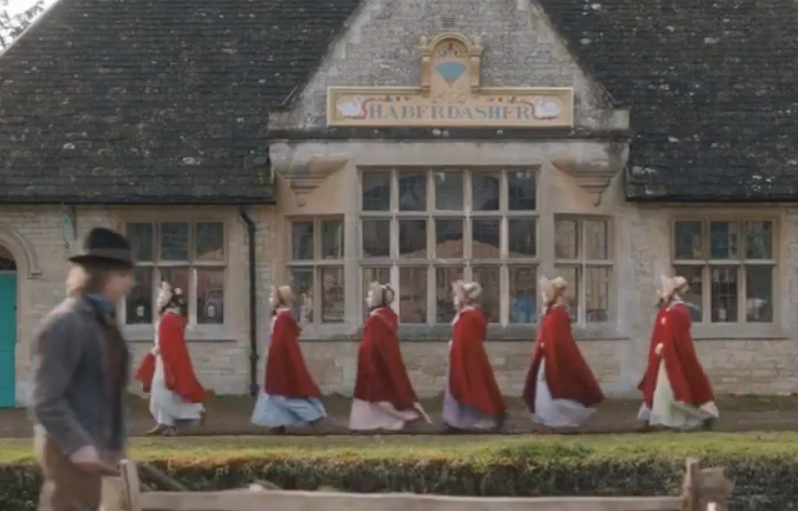 Image of a line of girls in red robes