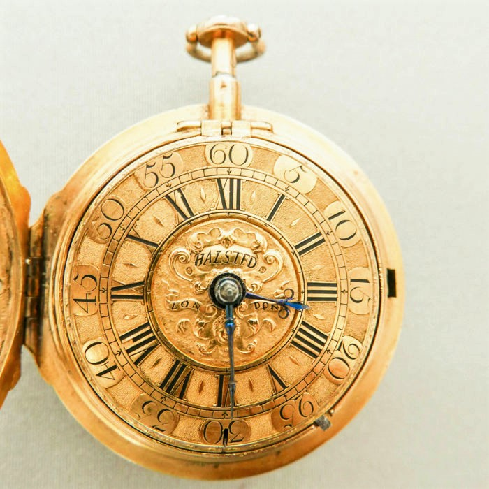 Gold pocket watch opened, with cover and numerals inside